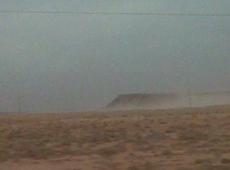 Dust-obscured view from Highway 66 westbound through Arizona